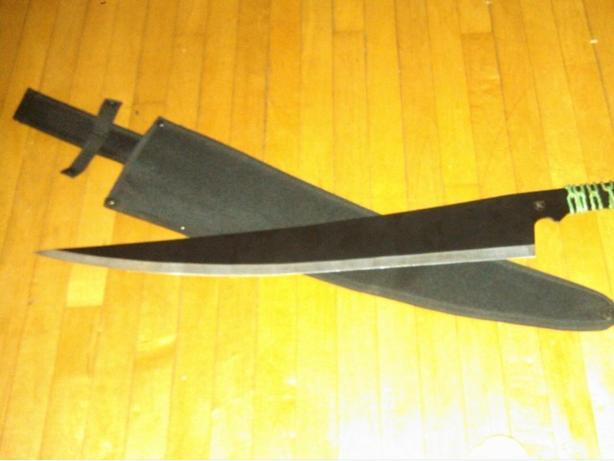 Decorative green and black machete