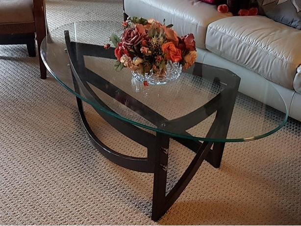 OVAL GLASS COFFEE TABLE PRICED TO SELL