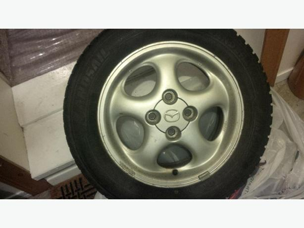 "14"" Mazda Alloys 4x100 w/ 185/60r14 Tires"