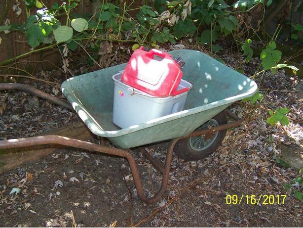 Old steel Wheelbarrow with lots of life left plus FREEBIES tossed in.