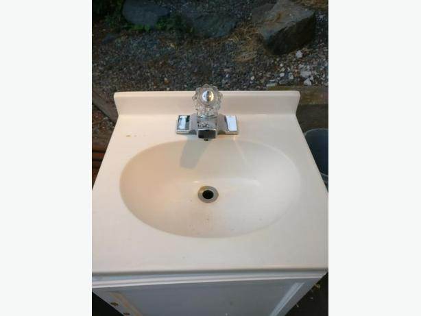 bathroom sink tap and sink