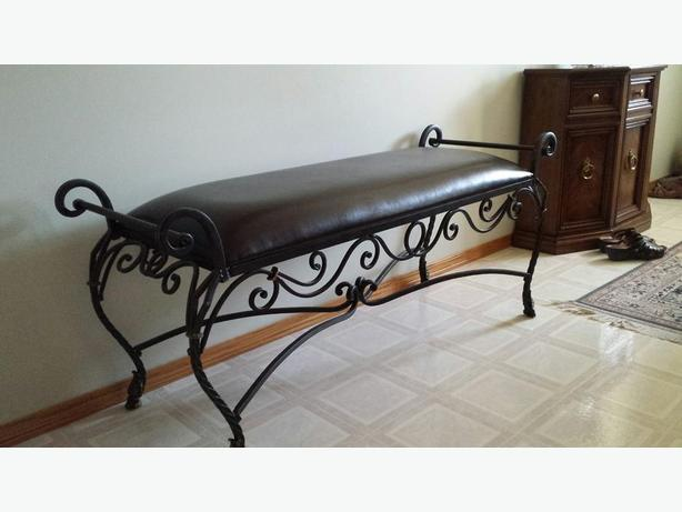 wrought iron and leather benches