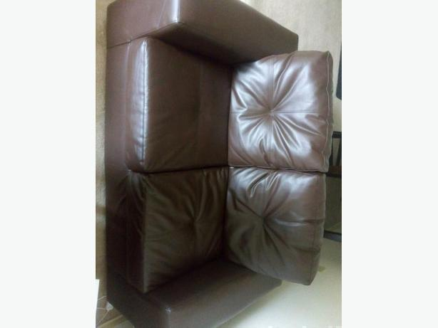 Dark brown couch and love seat