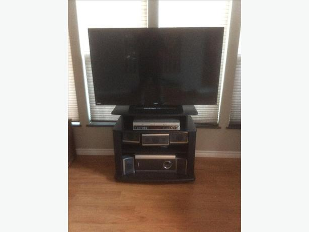 Tv,stand,surround sound w/ built in DVD VCR