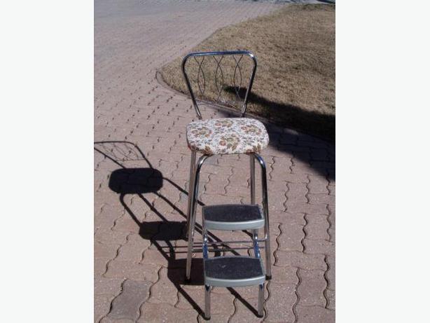 chair is chrome , vintage , retro , foldout down-steps utility chair