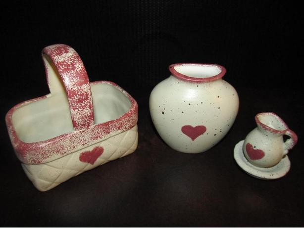 THREE MATCHING CERAMIC DECORATIVE PIECES