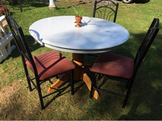 white wooden table with 3 chairs