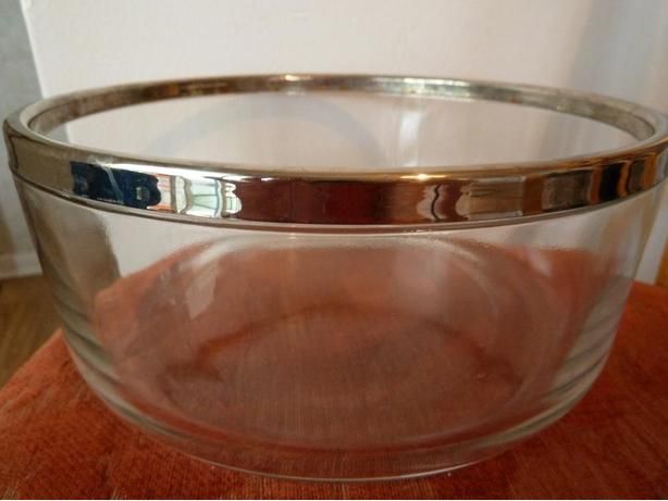 large glass bowl with silver edge