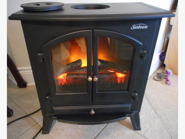 sunbeam electric fireplace. SUNBEAM ND20 portable Electric fireplace 1 500 watts Central
