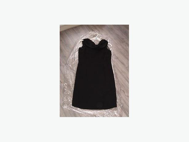 black dress         by Jessica , size 8