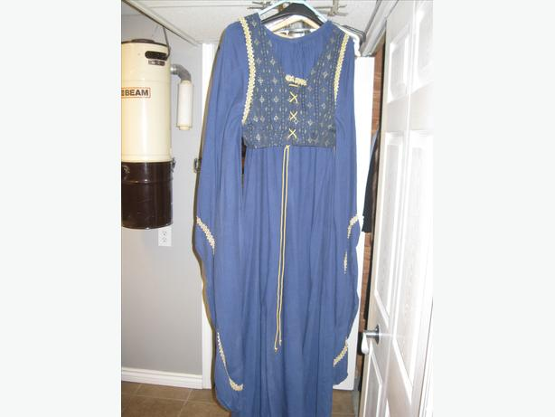 medival gown blue with gold trim lace and tie in front