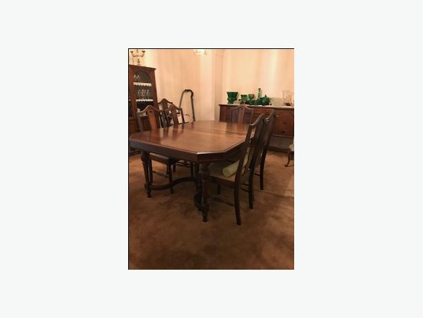 dining room table, 6 chairs, and a hutch