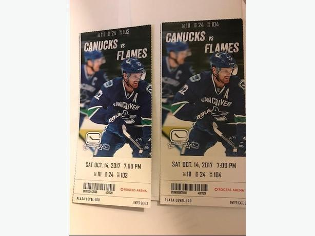 Canucks vs Flames  Sat.   2 lower bowl tickets for $180