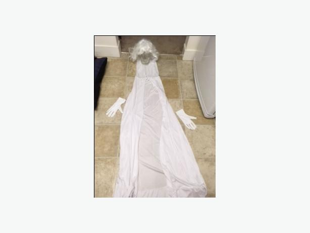 woman in white costume