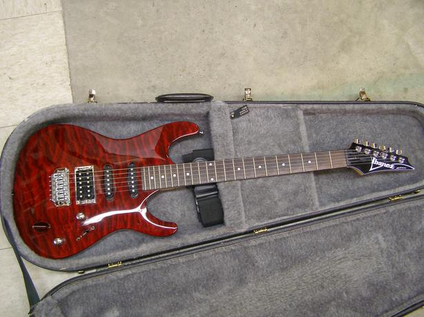 Right hand Ibanez SA160QM SA series electric guitar with hard case