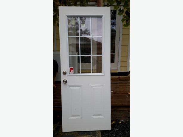 Exterior door with hardware