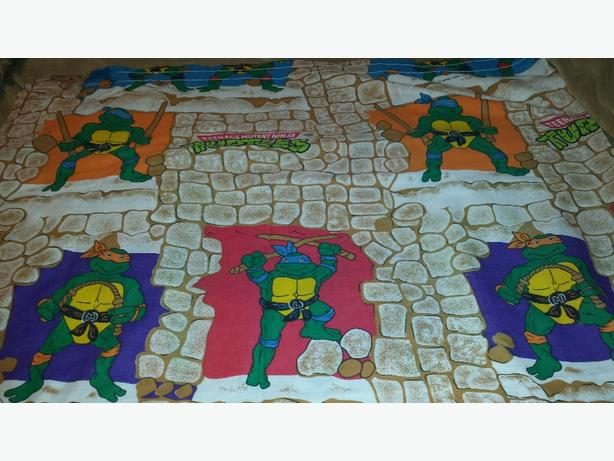 Two 84 inch wide by 60 inch long Ninja Turtle window panels