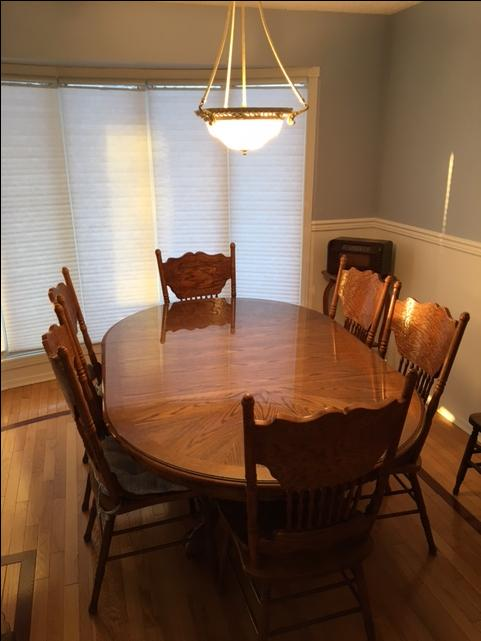 Wooden pedestal dining room table and pressed back