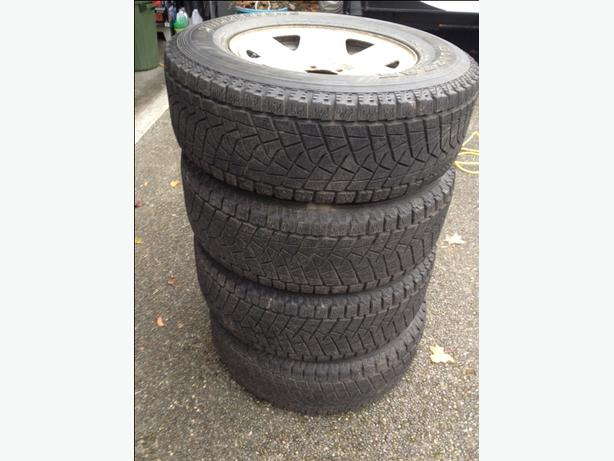 Set of 4 Bridgestone Blizzak Winter Tires on Toyota Tacoma Rims
