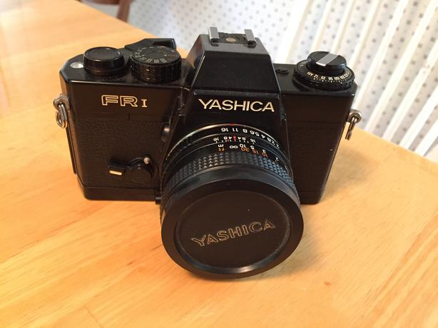 YASHICA CAMERA WITH ZOOM LENS