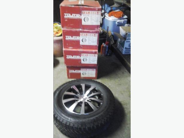 "Set of brand new 15"" mag rims & newer 205/70/15 all weather tires"