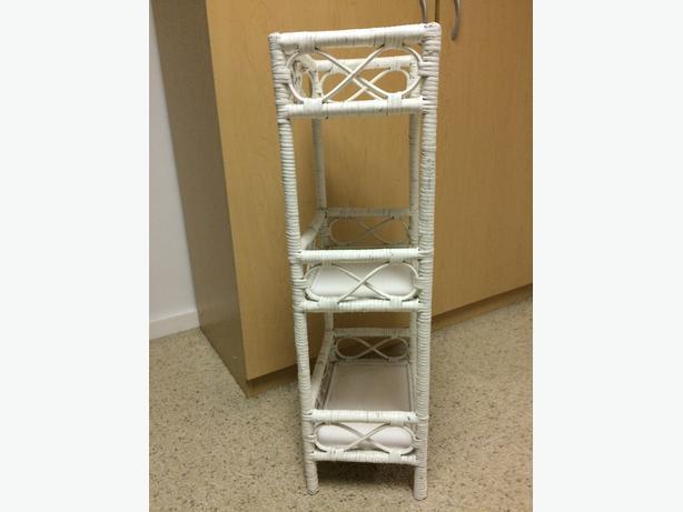 small white wicker shelf