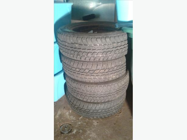 set of used studded snow tires