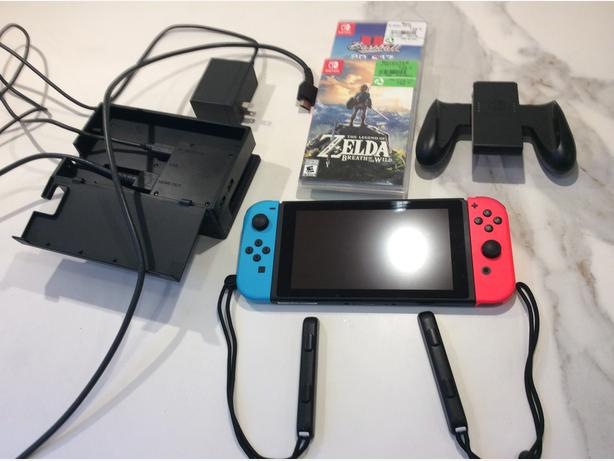 Nintendo switch console with Zelda Breath of the Wild and RBI Baseball