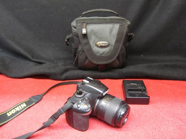 Nikon D3200 24MP digital SLR camera with Nikon DX VR lens and case
