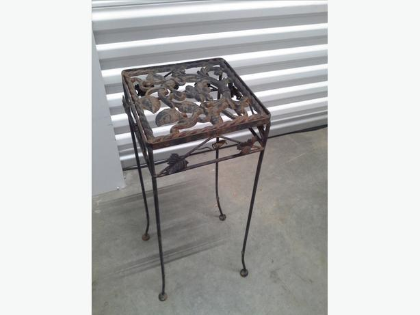 Old wrought iron plant stand