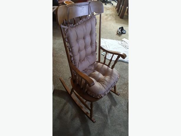 solid wood rocking chair with cushions. excellent condition.