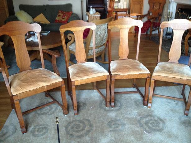 four matching canadiana oak chairs