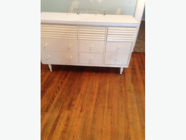 Used  Two triple Dressers and two chests and one wall unit.