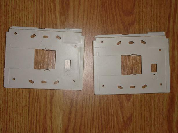 2 New Plastic Wall Mounted Brackets Security System - $2 each