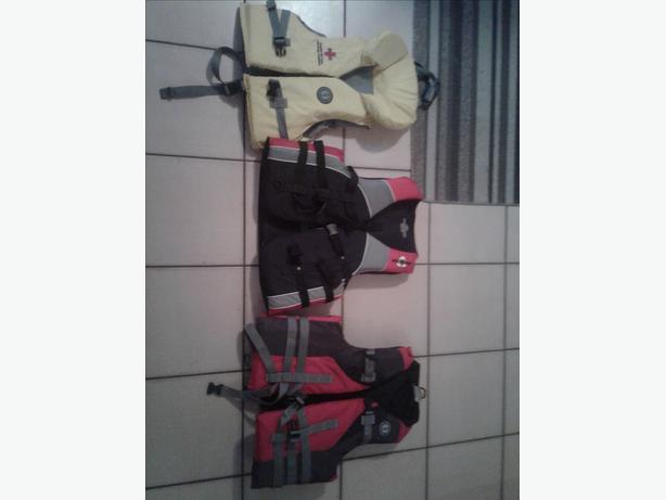 2 LIKE NEW ADULT LIFE  JACKETS AND ONE USED CHILDS