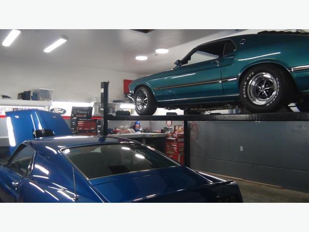 MUSTANGS AND OLD FORDS very well cared for at Dave's speed and performance shop