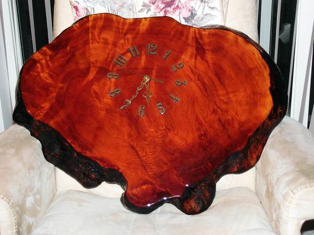 "SOLID REDWOOD CLOCK,36"" DIAMETER X 2.25"" THICK,WITH NEW CLOCK"