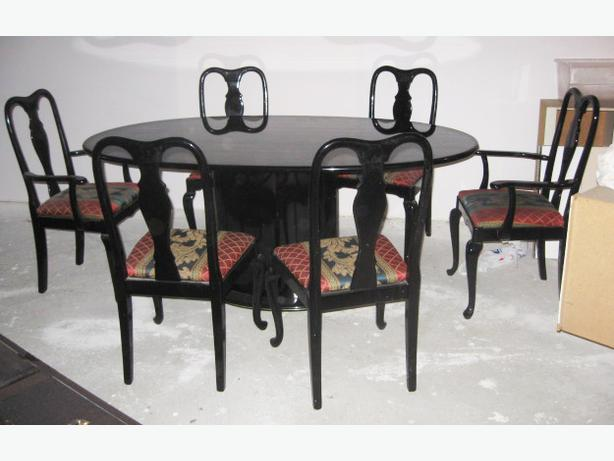 Dining room suite oval black lacquer as pictured solid and good condition.