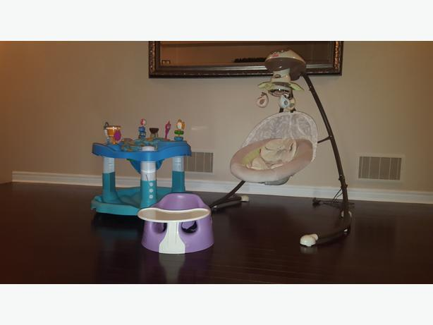 Baby swing, exersaucer and bumbo chair with tray