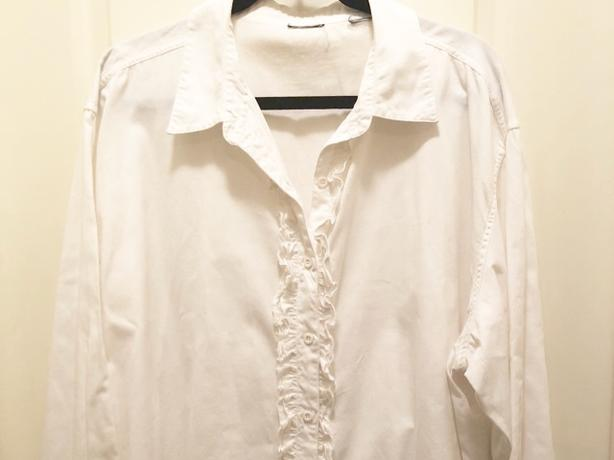Cute white blouse with ruffle detail