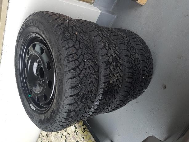 Full set 215/60R16 studded winter tires on rims