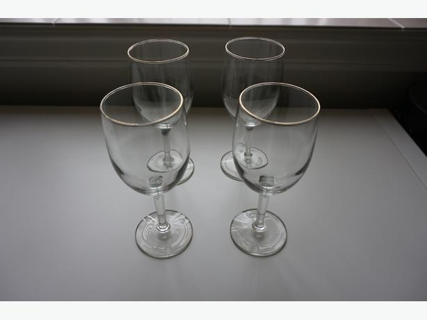 4 wine glasses and a wine rack
