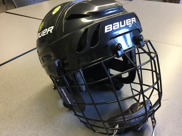 Two Bauer skating/hockey helmets