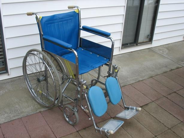 SKY BLUE INVACARE WHEELCHAIR WITH LEG RESTS FOR SALE