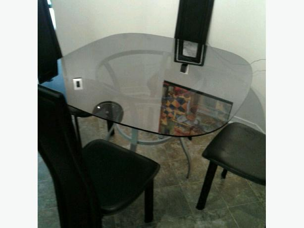 Modern glass top dining table. Brand new condition. Best offer