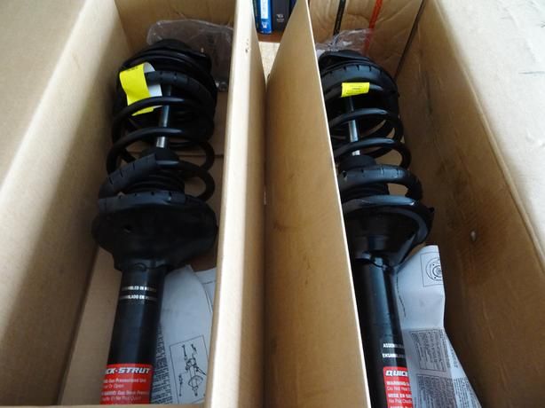 Brand New Monroe Quick-Strut Complete Rear Shocks Assembly