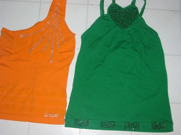 TWO BRAND NEW TOPS ONE IS BEBE