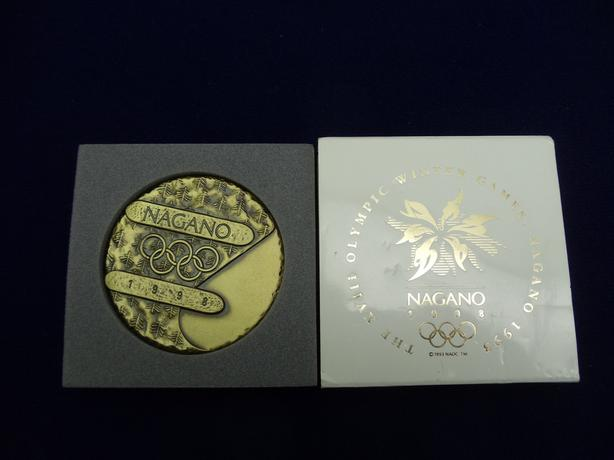 1998 official olympic participation medal and more.willing to take trades