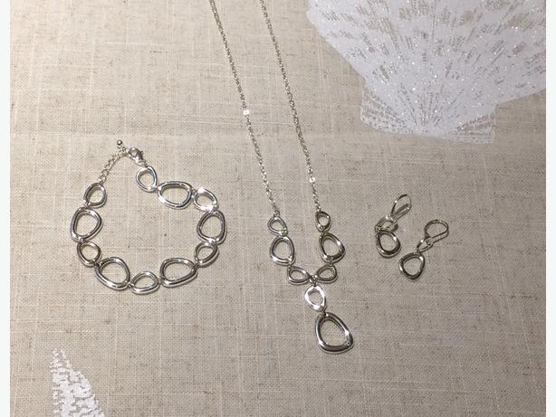 Matching jewelry set. Necklace, bracelet, and earrings. $2
