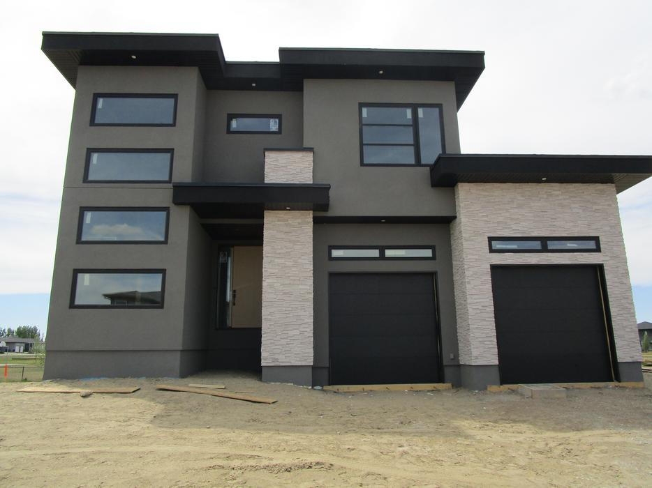 Jr 39 s stone and stucco complete exterior solutions soffit fascia eaves central regina regina for Exterior home solutions ottawa